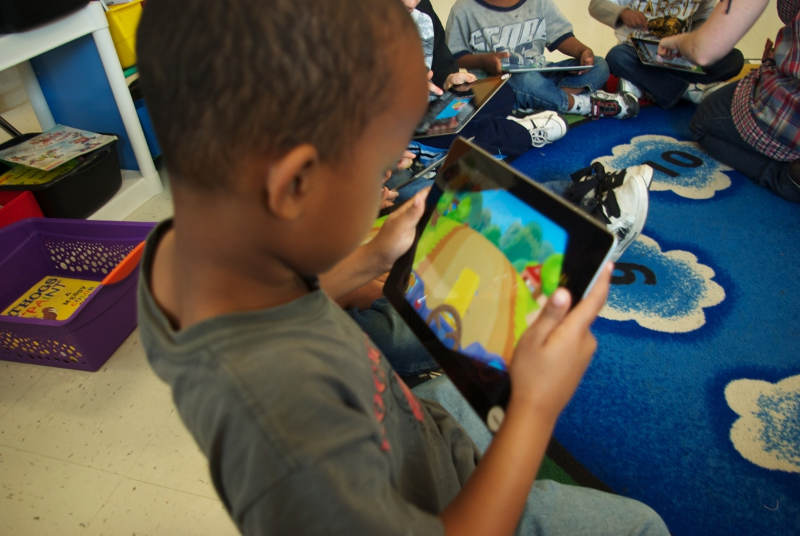 Auburn Kindergartener with his iPad