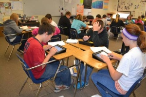 Students learning with tablets
